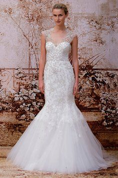 This is a beautiful Ivory embroidered tulle and Chantilly lace dress that is styled as a modified trumpet gown. It is from Monique's Fall/Winter 2014 collection so you would be one of the first brides to wear it! The gown also has illusion cap sleeves  and a truly spectacular keyhole back (not pictured) which makes the gown so unique and incredible. You will receive so many compliments on this special gown! Monique Lhullier is truly a goddess and her dresses are out of this world amazing…