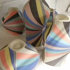 stripes and pschadelic colors to spice up these porcelain vases via peterpincusporcelain.jpg
