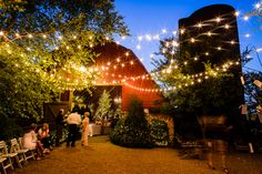 Barn Wedding At Night - i like the lights outside and chairs to cool off after dancing