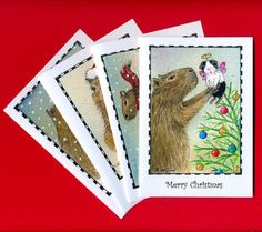 "This pack consists of 8 cards, with envelopes. They measure approx. 6 x 4"", and the pack is supplied in a grip-top polythene bag, so you can keep your cards in pristine condition once opened.    The cards illustrate four different Christmas scenes which I have taken from my Little and Large, Guinea Pig and Capybara series of original ACEO paintings - of which I have, to date, completed over 50! The pack consists of 2 of each design. $13.50"