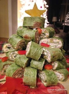 Christmas Tree Sausage Wraps: These delicious wraps are filled with pork, cheese and veggies, but you can fill them however you want. Make them ahead of time and refrigerate before serving, then stack them in the shape of a tree right before the Christmas party starts. Find more easy to make Christmas and holiday party appetizer ideas and recipes here.