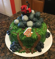 The boulders on top are made from sour cream donut holes, covered.in white chocolate 4th Birthday Cakes, 6th Birthday Parties, Birthday Bash, Birthday Party Decorations, Birthday Ideas, Little Man Birthday, Sons Birthday, Third Birthday, Dinosaur Party