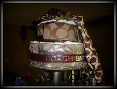 Coach baby diaper cake
