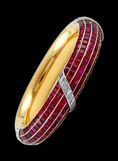 VAN CLEEF & ARPELS Diamond Ruby Brangle. 18k Y/G and Platinum Ruby and Diamond Bangle. Signed and Numbered by Van Cleef & Arpels. Circa 1980