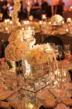 Mirrors and candlelight ~ The Best Wedding Centerpieces of 2013 ~ Photography: Victor Sizemore Photography | bellethemagazine.com