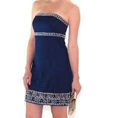 Stunning Lilly Pulitzer Navy formal dress Wow! This is one beautiful dress Lilly Pulitzer Navy strapless dress Intricately stunning bead and sequin detailPearl or Silver Accessories will Perfect This Look 10 excellent condition with no missing beads or sequins Very classy Lilly Pulitzer Dresses Strapless