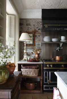 French country kitchen, La Cornue range, copper pots susanburnsdesign.com