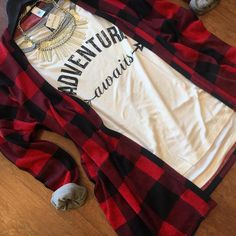 Buffalo plaid cardigan + graphic tee = love! Add distressed jeans and booties to complete the look.