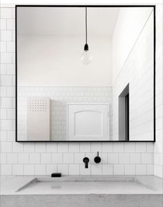 Matching the mirror, faucet and light makes things look polished
