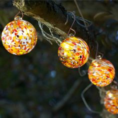 Beautiful lanterns to hang in a garden - looks like they would create a gorgeous atmosphere at night.