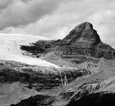 'Isolated Peak'  Add this to my already long list of peaks to bag this summer could be a sleep in the car at Lake Louise and bag it early kind of day...this is getting out of hand!  #mountaincultureelevated #blackwhite #totescanadian #natgeo #themountainiscalling #rockymountains #wanderlustalberta #canada #natureaddict #banff #tlpicks #passionpassport #welltravelled #eklusive_shot #lifeofadventure #wildernessculture #choosemountains #ourcamplife #getoutside #BC #hike #liveauthentic…