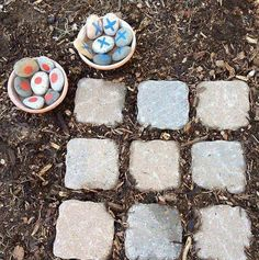 Awesome idea for a game out in the yard! Use big tiles for the squares and paint rocks for the pieces.... fun!