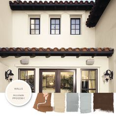 Exterior Of A Spanish Style Luxury Home With Stucco Walls A Red Tile Roof And Mexican Tile Patio