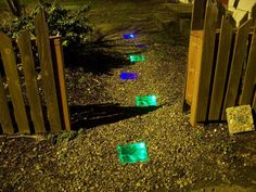 Light up your walkway with amazing, colourful glass blocks! (I want to put these by the side of the path rather than the center.)