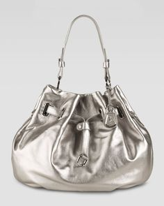 Metallic silver pouch bag for Fall.