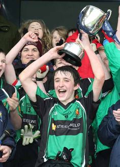 "The trophy for the victorious GAA Gaelic football team in the Ulster (under vocational schools division) is the ""McDevitt Cup"" 14 Year Old, Football Team, Division, Victorious, Schools, Football Squads, School, Colleges"