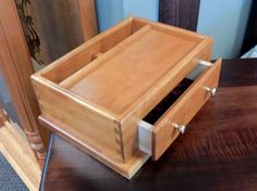Amish built men's valet crafted from Cherry in a natural finish.  This is a wonderful piece to give that someone special a perfect spot for his wallet, phone, watch, change, etc. at the end of the day!  (One currently available)