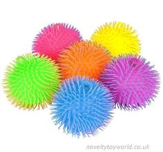 Novelty puffer balls in assorted two tone colours. A soft and squeezable sensory novelty measuring 21cm. Wholesale bulk buy from 72 units.