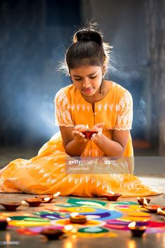 Young Girl Making Rangoli Decorating With Oil Lamps For Diwali Photography , Diwali Photography, Kerala Wedding Photography, Festival Photography, Dehati Girl Photo, Girl Photo Poses, Girl Poses, Diwali Pictures, Happy Diwali Images, Diwali Pics