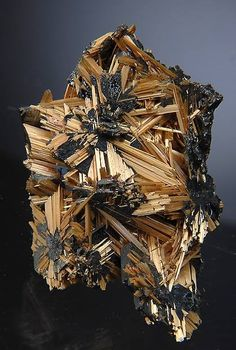 A beautiful example of golden Rutile sprays on metallic silver crystals of lustrous Hematite.