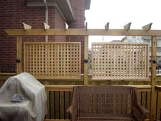 This Privacy Screen combines the look of a pergola with the screening of a trellis, all in the compact space of a back deck. In this case, the trellis is framed and hung from the pergola.