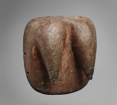 MAKONDE BODY MASK Of rounded rectangular form with two pointed female breasts with blackened nipples