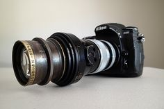 The Antique Camera Simulator aims to replicate the capabilities of classic lenses on modern day DSLRs through a clever use of various spacers, reduction rings, and adapters.  Pictured is a Krauss Tessar 180mm Lens on a modern Nikon D800.  From fstoppers.com January 26, 2014