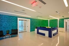 Lit Varia Vade wall feature with custom RGB lighting enhances this corporate lobby. Edge fins were used as a wall feature.