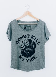 The Donut Kill My Vibe women's slouchy dolman t-shirt is made of high quality and comfy, vintage-inspired tri-blend fabric (50% Polyester 25% Cotton 25% Rayon). This tee features a Reaper holding a bo