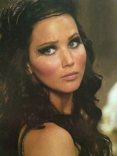 Katniss in catching fire. Favorite look of Jennifer. She might just turn me