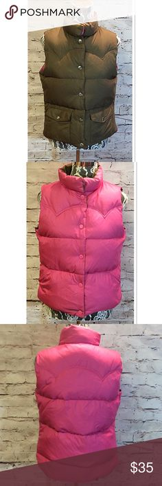 "AMERICAN EAGLE OUTFITTERS REVERSIBLE DOWN VEST This nice down vest will be a favorite this season with it's REVERSIBLE style from pink to a greenish brown, snaps to close. Excellent used condition. Lying flat armpit to armpit 20.5"" length 24"". C-3 American Eagle Outfitters Jackets & Coats Vests"