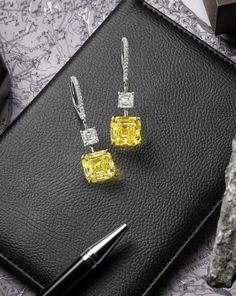 A Fine Pair of Coloured Diamond and Diamond Pendent Earrings, by Forevermark