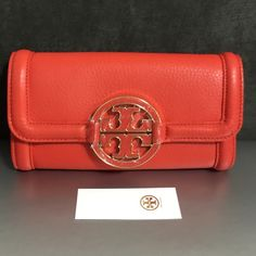 """Tory Burch Amanda Envelope Continental Wallet Brand New Tory Burch Wallet in Blood Orange color, pebbled leather, 12 card slots, 2 currency compartments, 1 center zipper compartment, fold-over closure, 7.5"""" L x 4"""" H x 5"""" D Tory Burch Bags Wallets"""
