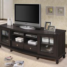 Our Best Living Room Furniture Deals Baxton Studio Udder Contemporary Dark Brown Wood TV Cabinet with 2 Sliding Doors and 2 Drawers Home Entertainment, Entertainment Centers, Entertainment Furniture, Dark Wood Tv Stand, 70 Inch Tv Stand, 70 Inch Tvs, Tv Stand With Drawers, Tv Stand Cabinet, Glass Panel Door