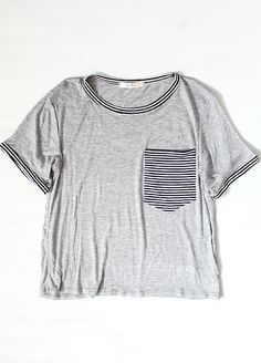 Our+favorite+not-so-basic+crop+top!+Heather+gray+crop+tee+features+stripe+front+pocket+and+stripe+hems.+Material+is+super+soft+and+tee+has+a+semi-loose,+semi-cropped+fit.+Wear+this+tee+with+boyfriend+jeans+and+an+oversized+knit+cardi+or+flannel+for+a+rad+casual+#ootd!+    96%+Rayon/4%+Spandex  MA...