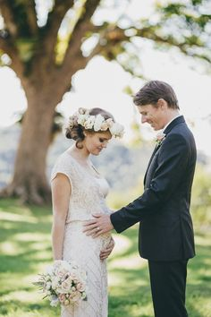So sweet! Pregnant bride with groom on wedding day | Mountain Top Elopement via @polkadotbride
