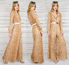 vintage 70s CHEETAH leopard print PALAZZO pantsuit JUMPSUIT bell bottom supermodel. $185.00, via Etsy.