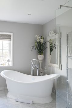 The volcanic limestone double-ended bath is large enough to accommodate Victoria and both children. The volcanic limestone double-ended bath is large enough to accommodate Victoria and both children. Gray Bathroom Walls, Light Grey Bathrooms, Beautiful Bathrooms, Bathroom Interior, Luxury Bathrooms, Bathroom Bench, Rental Bathroom, Ikea Bathroom, Bathroom Colors