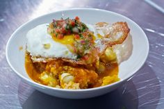 locro de quinoa. quinoa pumpkin stew, fried egg, choclo, parmesan cheese, crispy tomato