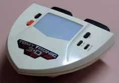 Vintage Tomytronic 3-D Thundering Turbo Electronic Handheld Game By Tomy, No. 7617, Made In Japan, Circa 1983