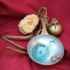 Bathing items: Sponge, Strigils, oil flask and glass scented perfumes. Romans used a sponge on the end of a stick soaked in brine.