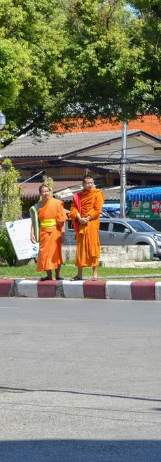 Monks and Red Truck - - - - - Two young monks waiting for the Red Turck Taxi to pass. #thailand #travel #photography