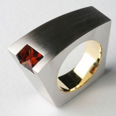 Ring-gold ( white or yellow ) 18K with spessartite garnet