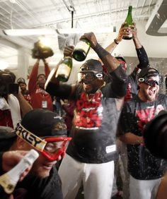 CrowdCam Hot Shot: Boston Red Sox player David Ortiz leads the celebration after they won the AL East with a win over the Toronto Blue Jays at Fenway Park. Photo by Winslow Townson