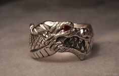 Sterling silver dragon head ring with a ruby eye. Going to be making more dragon rings like this. Low profile, nice for everyday wear. Available for purchse here: www.etsy.com/listing/1...