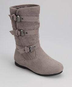 Three buckles?Toocute. These boots keep steps on track and ahead of the trends. A triple buckle-clad exterior meets a pull-on silhouette, crafting a pair that's both pretty and practical.7.25'' shaft9.5'' circumferenceSample size 6Pull-on...