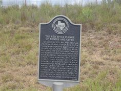 """The Red River Plunge of Bonnie and Clyde - Wellington, TX historical marker. Clyde Barrow missed a """"bridge out"""" sign and he, Bonnie, and W. D. Jones went into the ravine."""