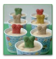 """Pup-sicle pops.  Ingredients  Three (3) 6-ounce containers of plain low-fat yogurt  ½ cup of low sodium peanut butter  One (1) 4-ounce jar of banana baby food  1 Tablespoon honey  Mix together and pour into disposable paper cups. Add dog bones on top of mixture to serve as """"handles.""""   Place cups on freezer. Once frozen, serve by peeling away the paper cup."""