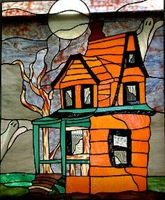 Halloween haunted house with ghosts stained glass