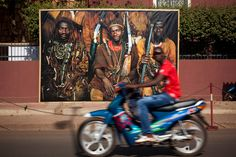 Photo by Damon Winter for the NY Times. During the 9th African photography biennial in Bamako, Mali, large-format reproductions of pictures are installed around to the city to bring the exhibition into the streets.